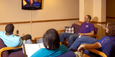 Students watch tv in the Village lounge at Penn State Berks
