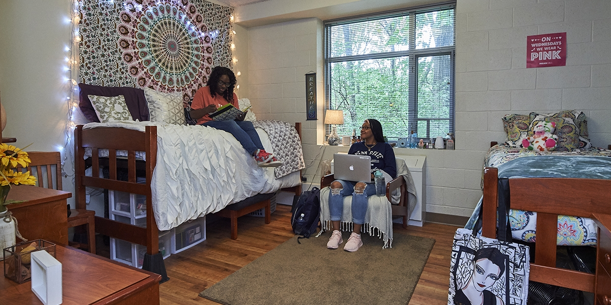 two students hanging out in a double suite